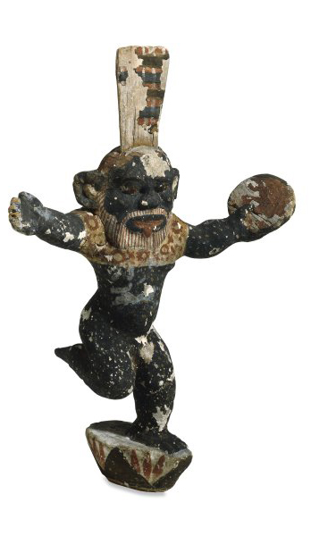 Wooden figure of Bes playing a tambourine